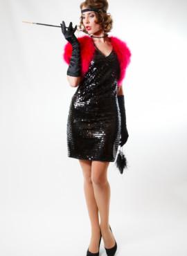 Костюм  в стиле 20-30х годов состоящий из черного платья в пайетку и розового балеро